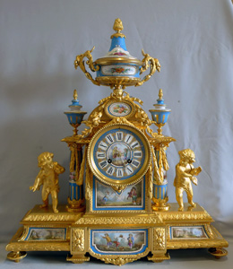 Big antique French ormolu and jewelled porcelain clock with hand painted panels of children playing.