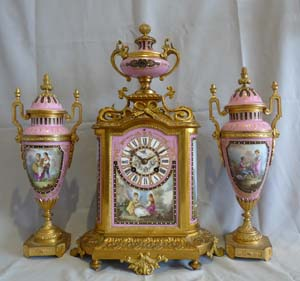 Antique French porcelain and ormolu clock set.