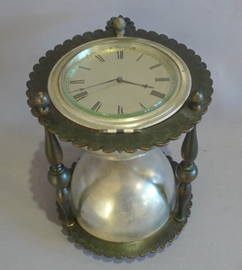Antique and rare desk clock in the form of an hour glass in patinated and silvered bronze.
