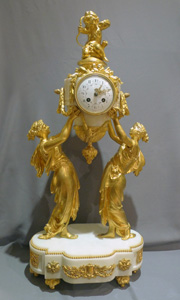 Antique French mantel clock of two women holding  up time.