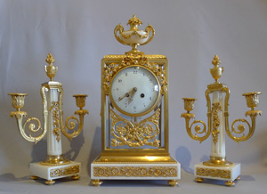 Antique French, white marble and ormolu four glass clock set.