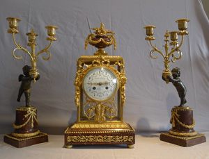 Antique French rouge marble and ormolu clock set with diial signed Julian Leroy a Paris.