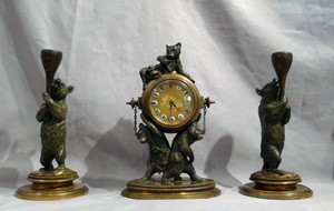 Unusual anthropomorphic bronze clock set of bears on a clock with bear candlesticks.