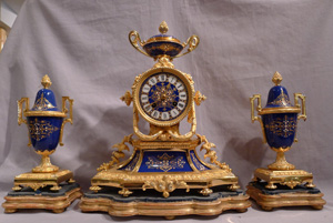 Antique French clock garniture in ormolu and enamelled ( jewelled) porcelain.