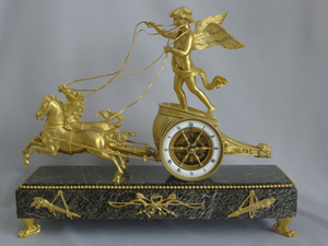 Antique French Napoleon III chariot clock in ormolu & marble vert.