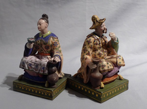Antique French chinnoiserie pair or porcelain seated figures.
