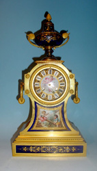 Antique French Napoleon III Blue de roi porcelain and ormolu clock.