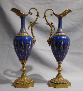 Antique French pair jewelled porcelain and ormolu ewers.