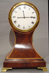 Antique English George III period small bracket clock in flame mahogany.