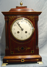 English Edwardian mahogany mantel clock.