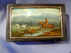 Antique French music box in bois de boeuf with hunting scene.
