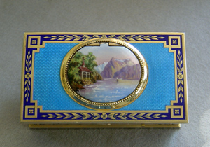 Fine French singing bird box by Juvinia in silver gilt and sky blue guilloche enamel.