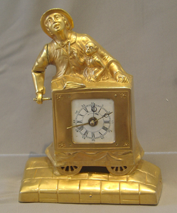 Swiss automaton organ grinder clock with musical box set off by the alarm..