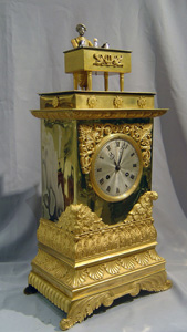 Antique automaton magician clock by bossu with more complications than that by Houdin.