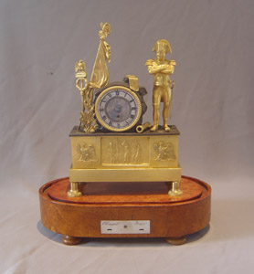 Napoleon Empire Egyptian theme mantel clock with musical movement signed Alibert.