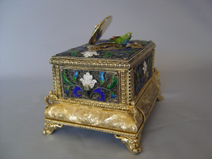 automaton singing bird box in silver filigree and silver gilt with enamel.