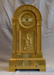French Empire antique ormolu mantel clock with musical movement.