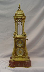 Antique automaton clock, French antique in ormolu and red marble.
