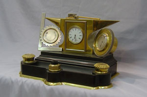 Antique industrial clock desk compendium, French in form of anvil and tools.