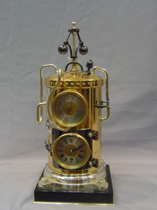 Antique industrial clock and automaton, French in form of a steam boiler.