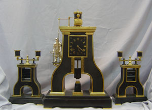 antique automaton clock set of industrial steamhammer and rollers.