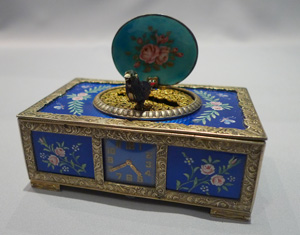 Rare singing bird box in silver and blue guilloche enamel with watch to front of case.