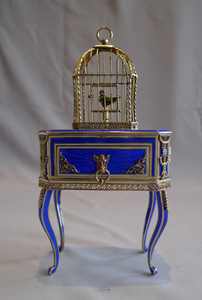 Rare singing bird box in silver gilt, iridescent blue guilloche enamel and ivory.