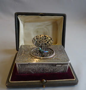 Antique singing bird box in silver with original box by unusual Swiss maker.