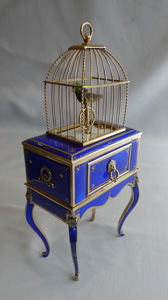 Singing bird box in silver and electric blue guilloche enamel.