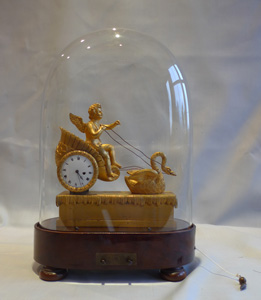 French Empire miniature ormolu clock with two tune musical base.