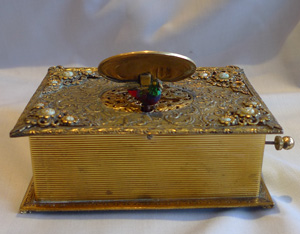 Singing bird box in book form of gilt bronze, jewelled and enamel.