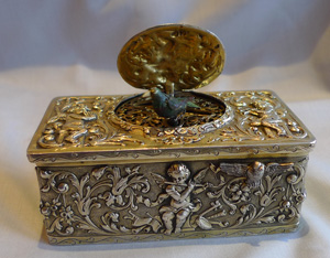Singing bird box in solid silver case, high quality early Griesbaum.