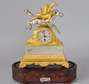 Charles X silvered bronze and ormolu miniature mantel clock on musical base.