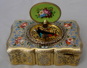 Antique Bruguier singing bird box, fusee movement, silver gilt and enamel case.