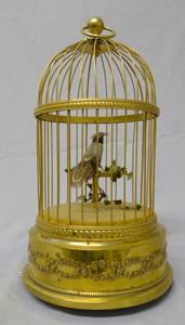 Singing bird cage with single bird by Bontems.