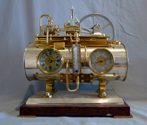 Antique French automaton clock of boiler with flywheel and govenor.