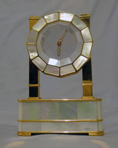 Mystery clock in silver gilt, mother of pearl and rock crystal by Imhof