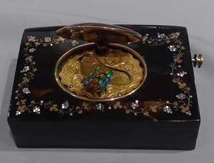 Antique singing bird box tortoiseshell and pique work in gold and shell.