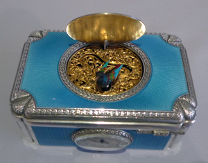 Singing bird box in solid silver and all over electric blue guilloche enamel with watch by Raymys.