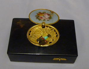 Antique singing bird box by Rochat in tortoiseshell , enamel and silver gilt.