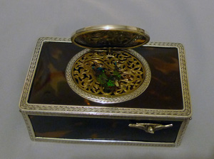 Singing bird box silver with tortoiseshell panels and lid.
