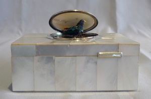 Singing bird box automaton in mother of pearl and silver.