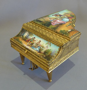 Antique musical grand piano in hand painted enamel and fine gilt bronze.
