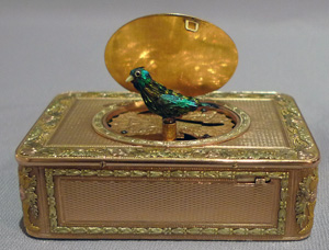 Antique singing bird box by Rochat in four colour gold and hardstone decoration