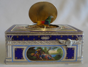 Singing bird box in silver and fine hand painted and guilloche enamel .