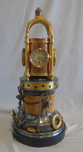 Antique Industrial automaton clock in the form of a ship's capstan.