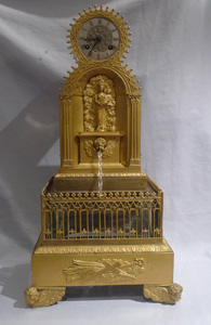 Antique automaton ormolu Gothic revival water clock in form of a fountain.