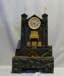 Antique French automaton striking mantel clock with moving water and waterwheel.