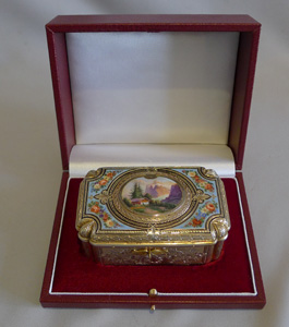 Antique Bruguier fusee singing bird box in silver gilt and enamel.