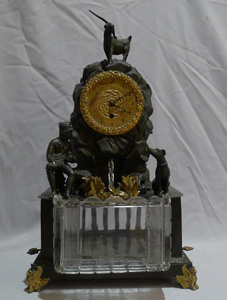 Antique automaton bronze mantel clock with moving water mechanism and hunting scene.